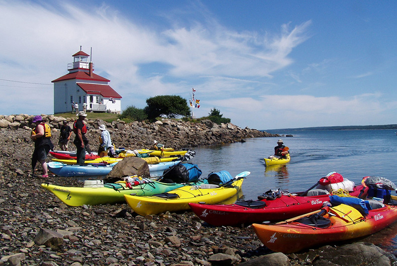 Kayaks at Gilbert's Cove Lighthouse